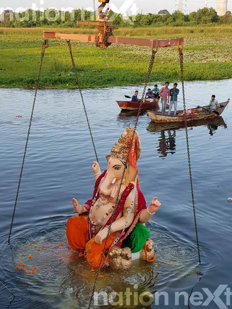 """""""Nagpur Cha Raja"""" immersed in Koradi Lake, after a procession of 20 kms"""