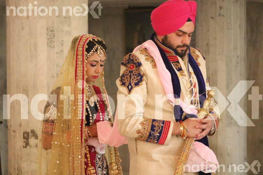 Harkeerat and Taranjeet Singh take their wedding vows at Gurudwara Singh Sabha