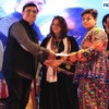 Aman Mansada receiving the best male dancer award at Dhamaal Dandiya by Sankalp