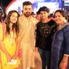 A family poses for a picture at Dhamaal Dandiya by Sankalp