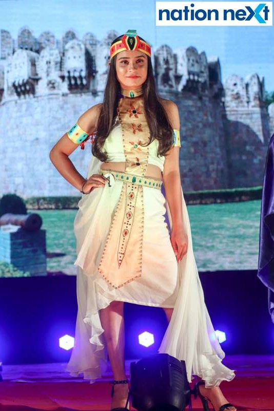 A model walks the ramp during IFT Fashion Carnival held in Nagpur