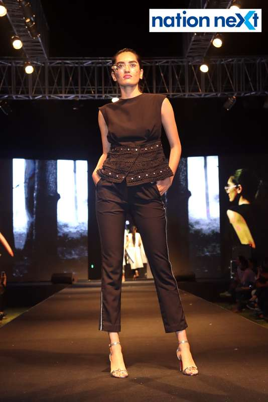 A model walks the ramp at Blenders Pride Magical Nights held at CP Club in Nagpur
