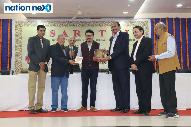 Tejas Deoskar being felicitated by Dr Brijesh Dixit and others at the 'Scroll of Honour' function organised by SARATHI in Nagpur