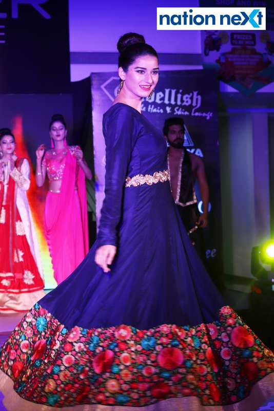 A model walks the ramp at a fashion show organised at Ginger Square in Nagpur