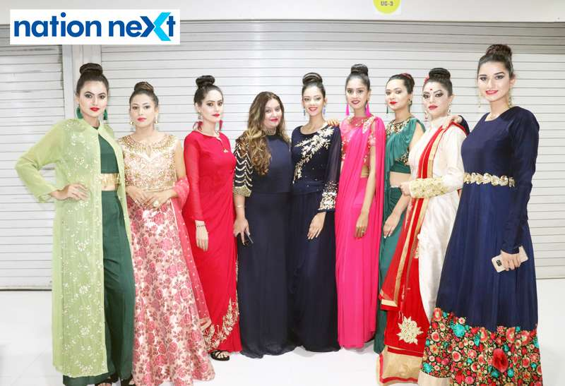 Priyanka Kothari (Owner, Amyraa - The Style Studio) with the models during a fashion show organised at Ginger Square in Nagpur