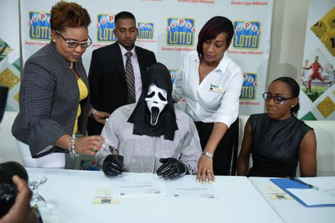 A lottery winner from Jamaica concealed his identity by wearing a mask while collecting Rs 9 crores to avoid sharing money with his 'cash-hungry' relatives.