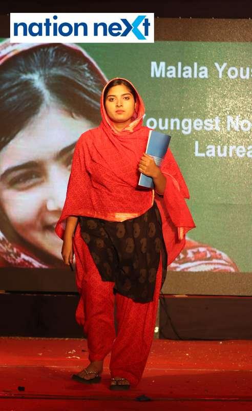 A student walks the ramp as Nobel Prize laureate Malala Yousafzai during PIET's cultural fest 'Saptrang' in Nagpur