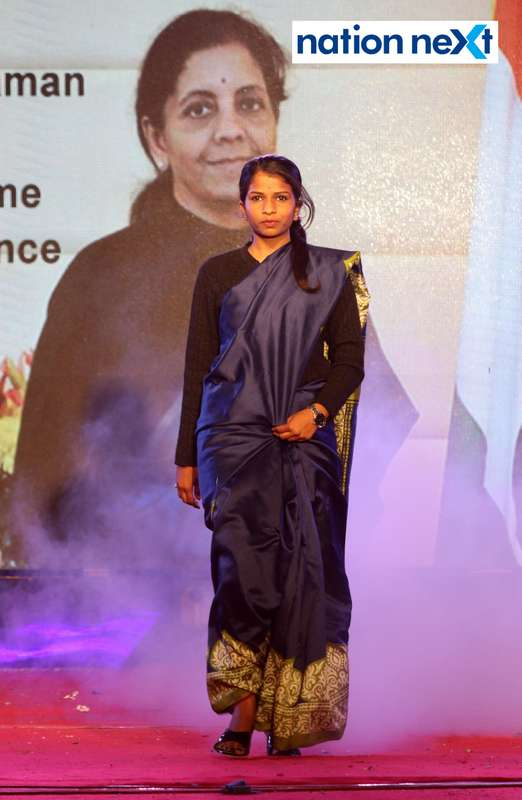 A student walks the ramp as Defence Minister Nirmala Sitharaman during PIET's cultural fest 'Saptrang' in Nagpur