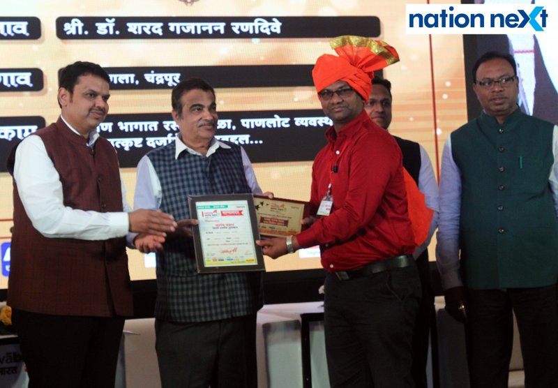 Maharashtra CM Devendra Fadnavis and Union Minister Nitin Gadkari felicitating a sarpanch during Navrashtra Sarpanch Samrat and Agritech Award ceremony in Nagpur