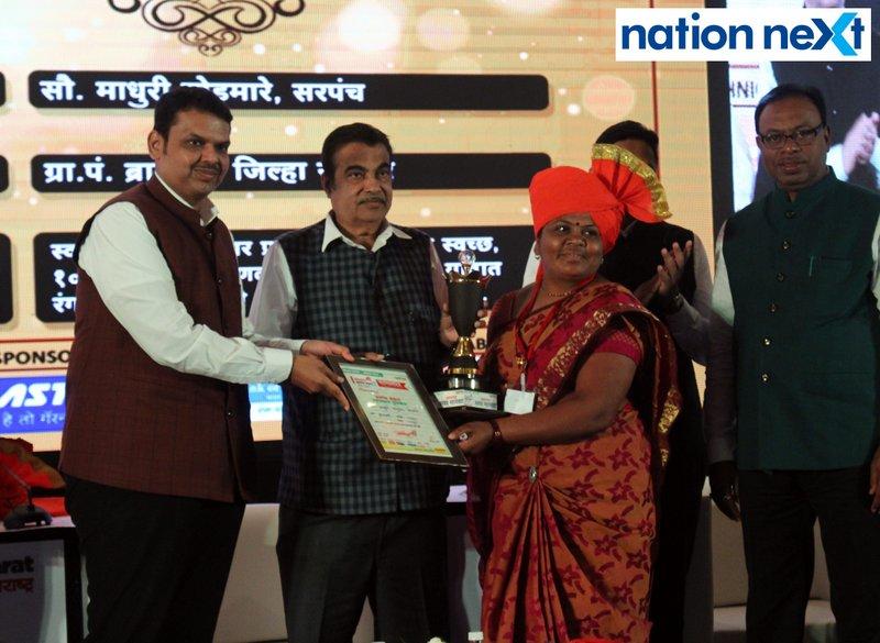 Maharashtra CM Devendra Fadnavis and Union Minister Nitin Gadkari felicitating a sarpanch during Navrashtra Sarpanch Samrat and Agritech Award ceremony in Nagpur