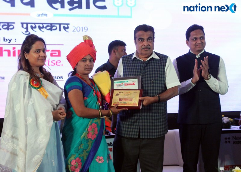 Union Minister Nitin Gadkari felicitating a sarpanch during Navrashtra Sarpanch Samrat and Agritech Award ceremony in Nagpur