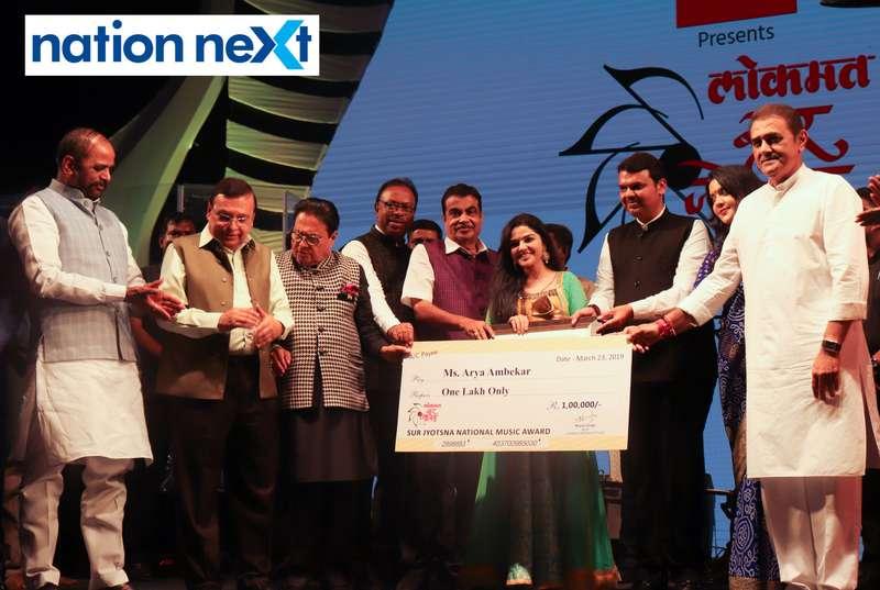 Union Minister Nitin Gadkari and Maharashtra CM Devendra Fadnavis felicitating Aarya Ambekar at Sur Jyotsna National Music Awards 2019 held in Nagpur