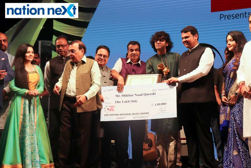 Union Minister Nitin Gadkari and Maharashtra CM Devendra Fadnavis felicitating Shikhar Naad Qureshi at Sur Jyotsna National Music Awards 2019 held in Nagpur