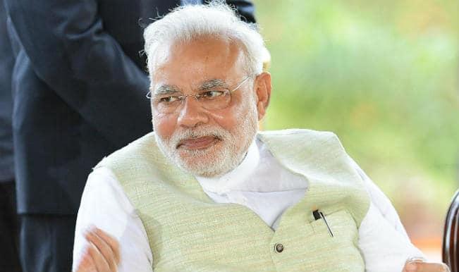 Karnataka Chief Minister HD Kumaraswamy said that Prime Minister Narendra Modi's face glows because he applies make-up and wax.