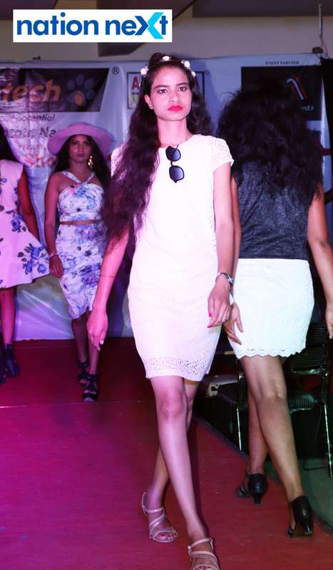 A student walks the ramp at the fashion show organised by Aptech Aviation Academy in Nagpur