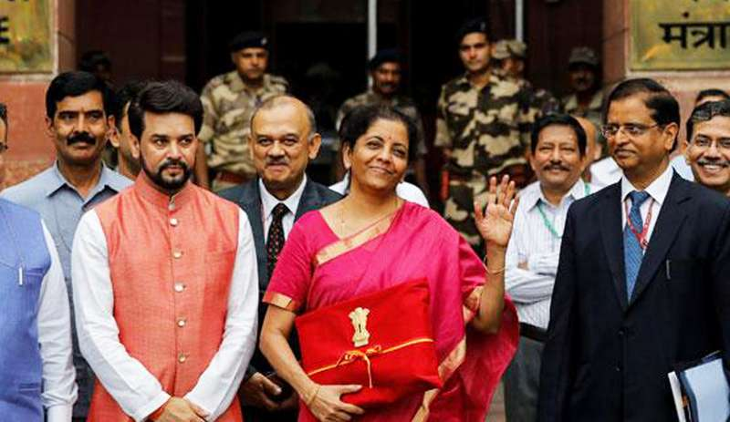 Finance Minister Nirmala Sitharaman gestures as she leaves her office to present the federal budget in the parliament in New Delhi. Photo: Reuters