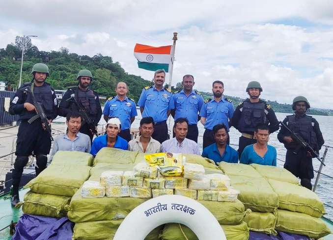 Indian Coast Guard with packets of Ketamine drug, weighing 1,160 kilograms, worth around Rs 300 crores and the six alleged smugglers. (Photo by: ANI)