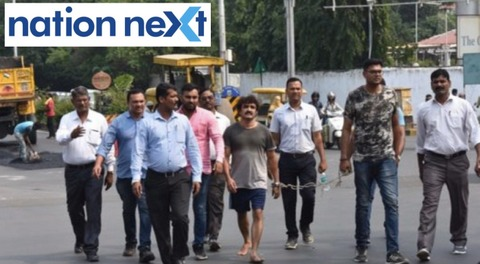 Dreaded underworld gangster Santosh Ambekar was taken magistrate court on foot at Akashwani Square in Civil Lines on Saturday afternoon.