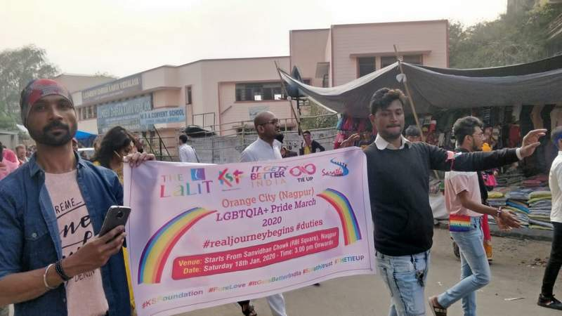 Youngsters carry a banner supporting LGBTQI community during Orange City Pride March in Nagpur