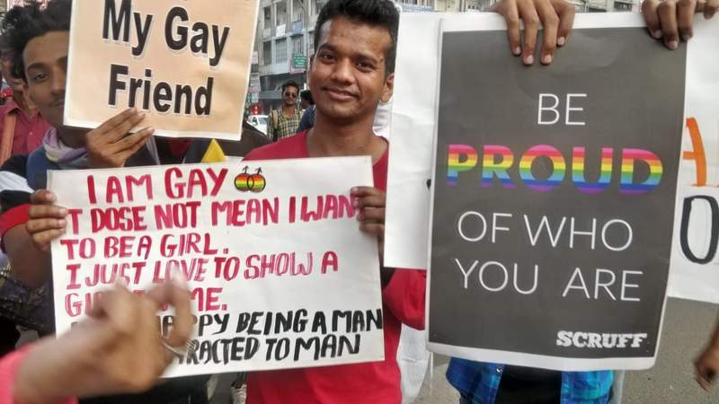 Youngsters carry placards supporting LGBTQI community during Orange City Pride March in Nagpur