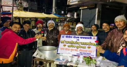 Panchpaoli Police officials distributing milk to citizens.