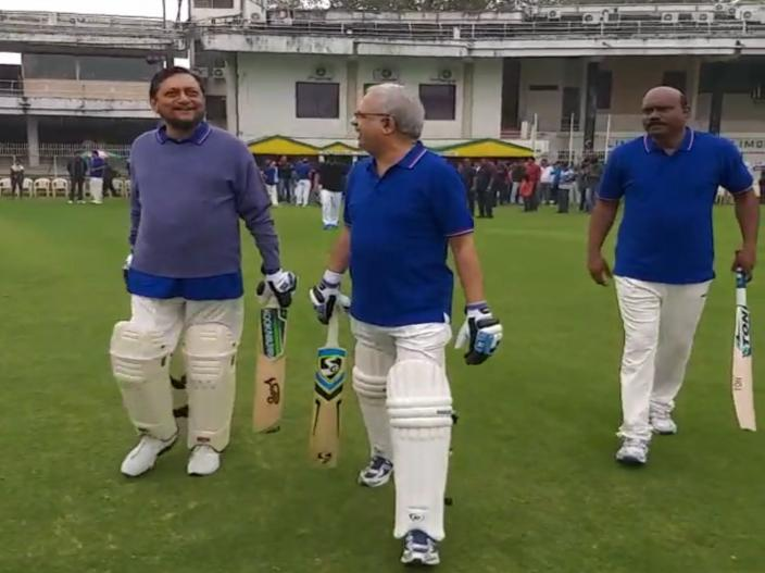 CJI Sharad Bobde heads towards the ground to bat during a match between Judges XI and HCBA President XI held at VCA Stadium in Civil Lines in Nagpur.