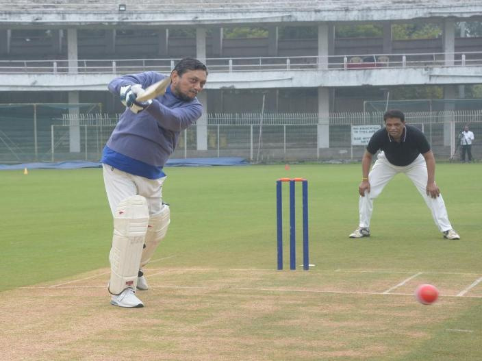 CJI Sharad Bobde smashes a delivery during a match between Judges XI and HCBA President XI held at VCA Stadium in Civil Lines in Nagpur.