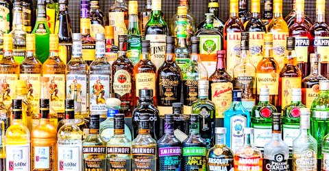 A cop and a driver were arrested for allegedly stealing 69 bottles of whiskey that were seized at a police station in Telangana.