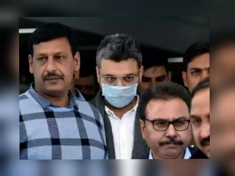 Sanjeev Chawla (centre) along with police officials